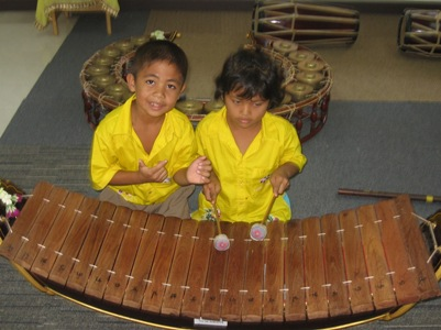 Children learning traditional Thai musical instrument - Andaman Discoveries