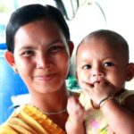 mother of a burmese learning center student in kuraburi with her baby
