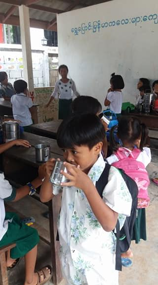 Students drinking soy milk at the Burmese Learning Center in Kuraburi